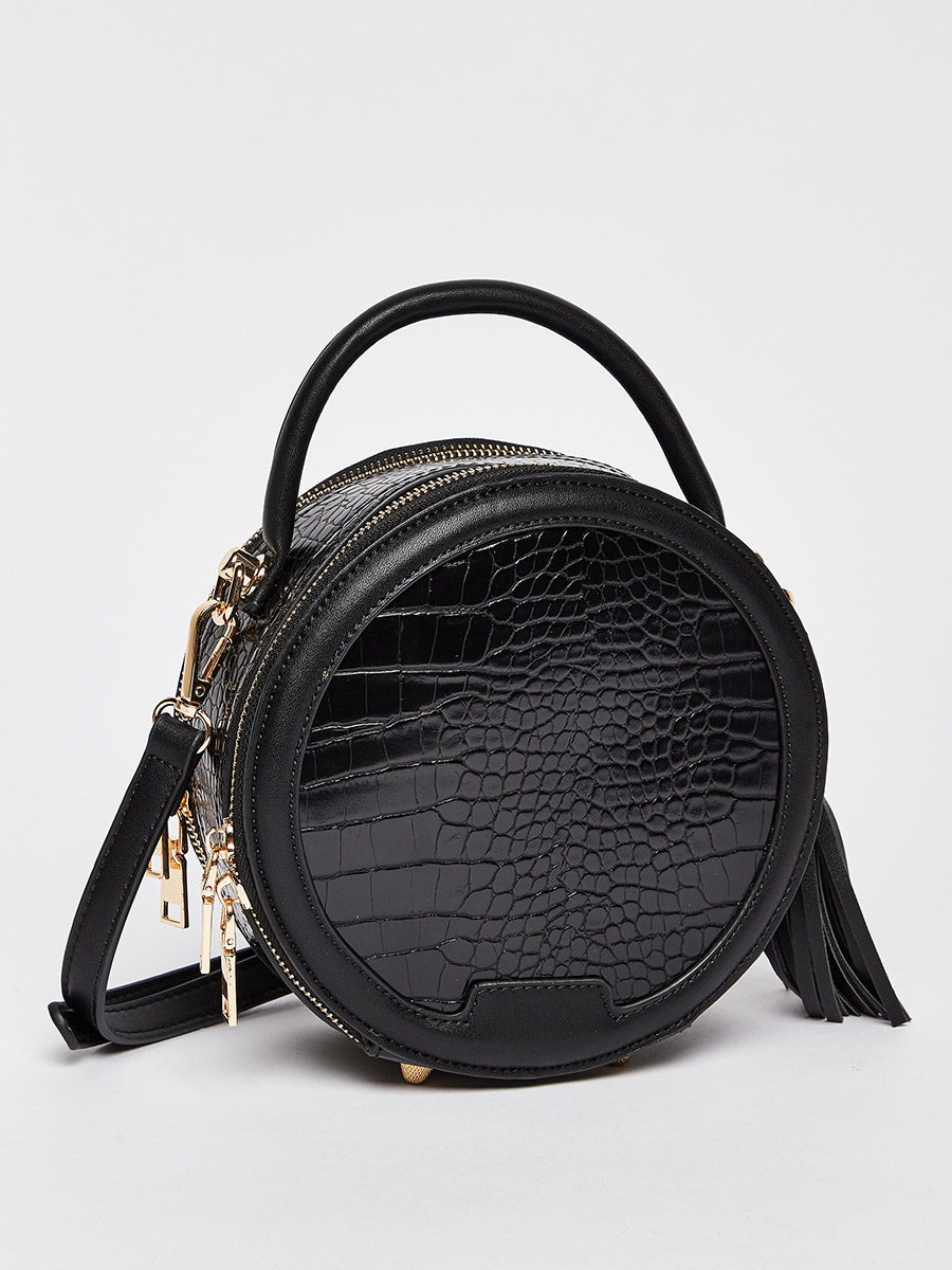 Textured round crossbody bag bought thanks to Styli discount code
