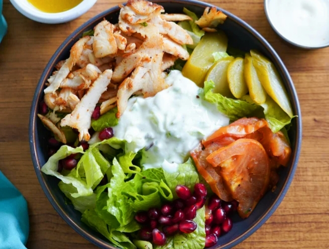 A bowl of chicken shawarma salad - iftar meal that you can order at Deliveroo