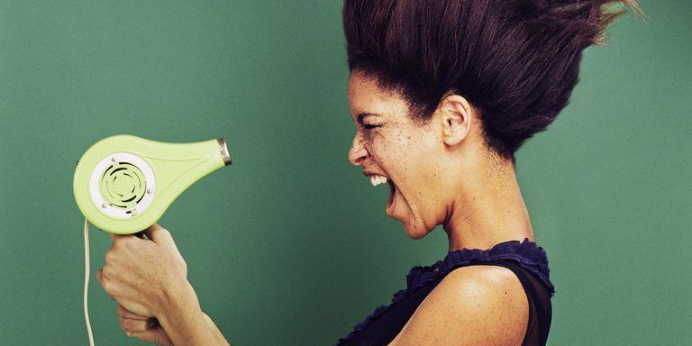 woman using hair dryer